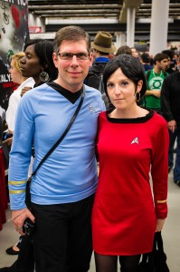 A pair of Trekkies at the 2012 Comiccon under the convention hall lighting.